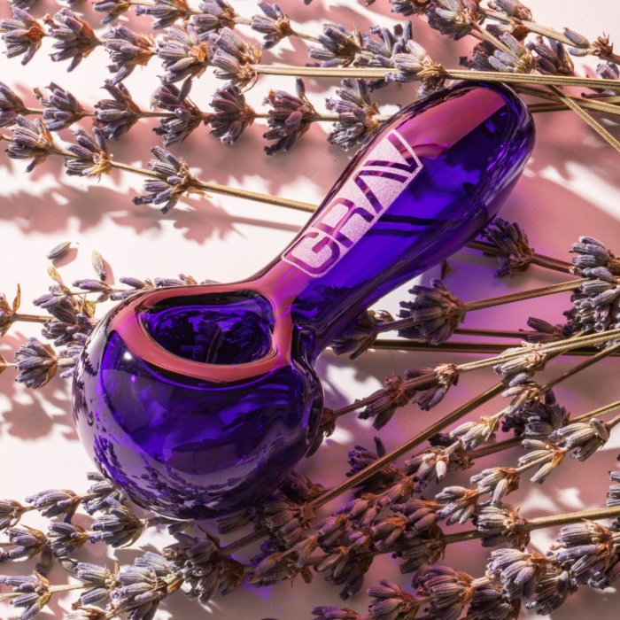 bright purple glass pipe cannabis product photography
