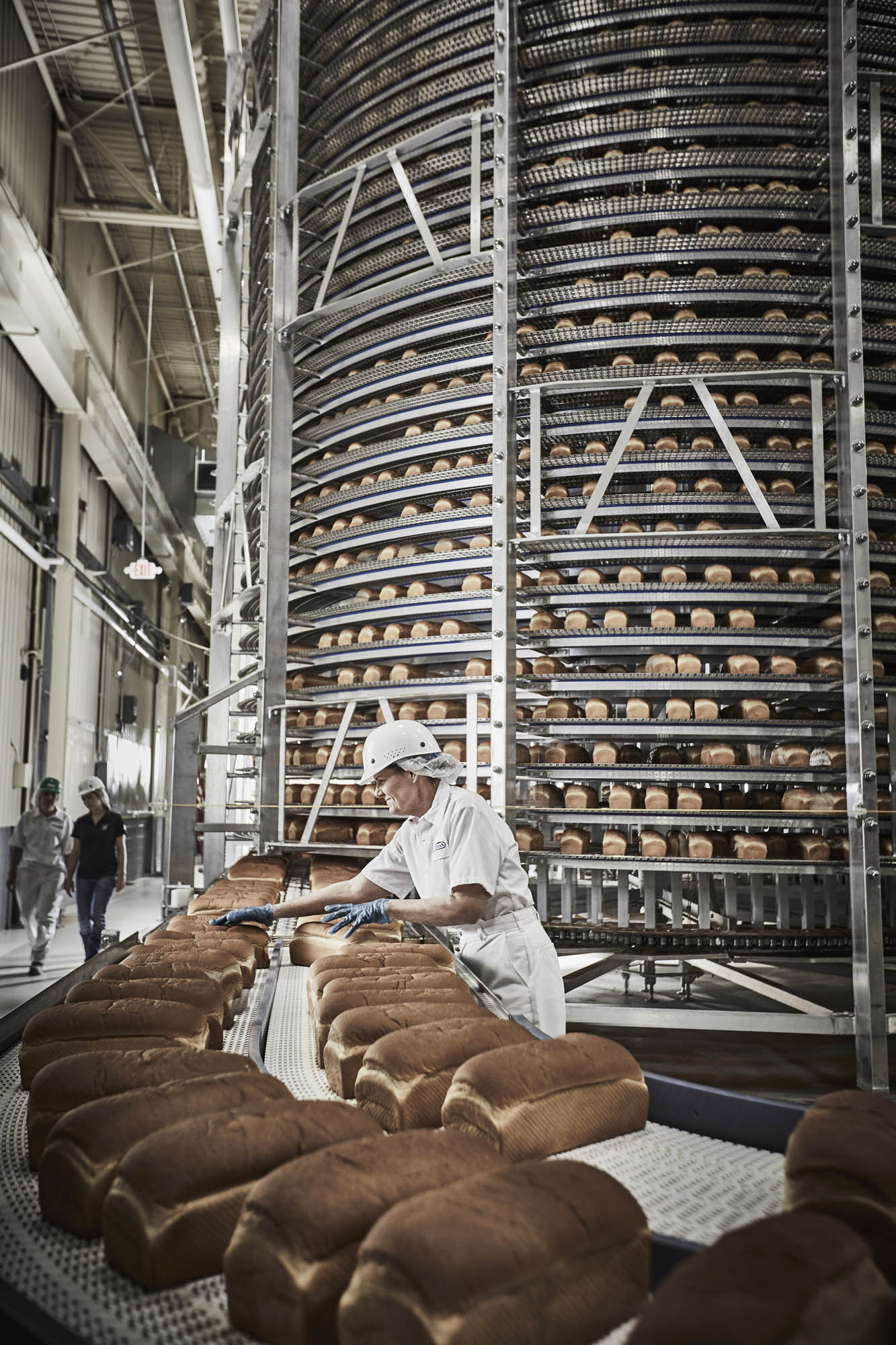 A tower of bread in before inspection in an industrial bakery