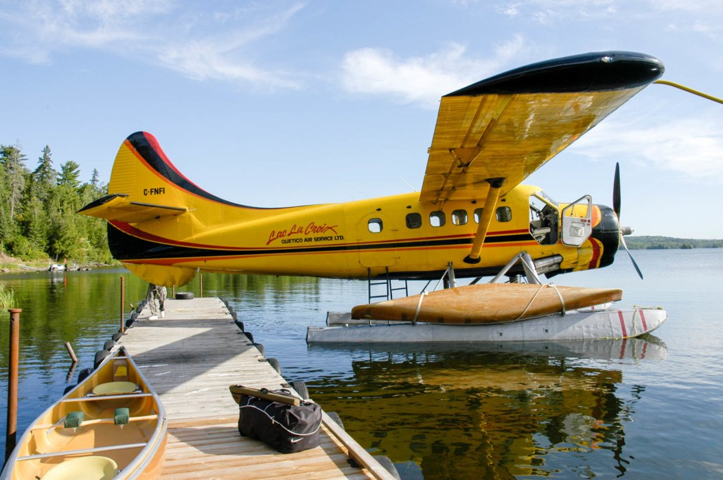 A Floatplane at the docks of a calm lake