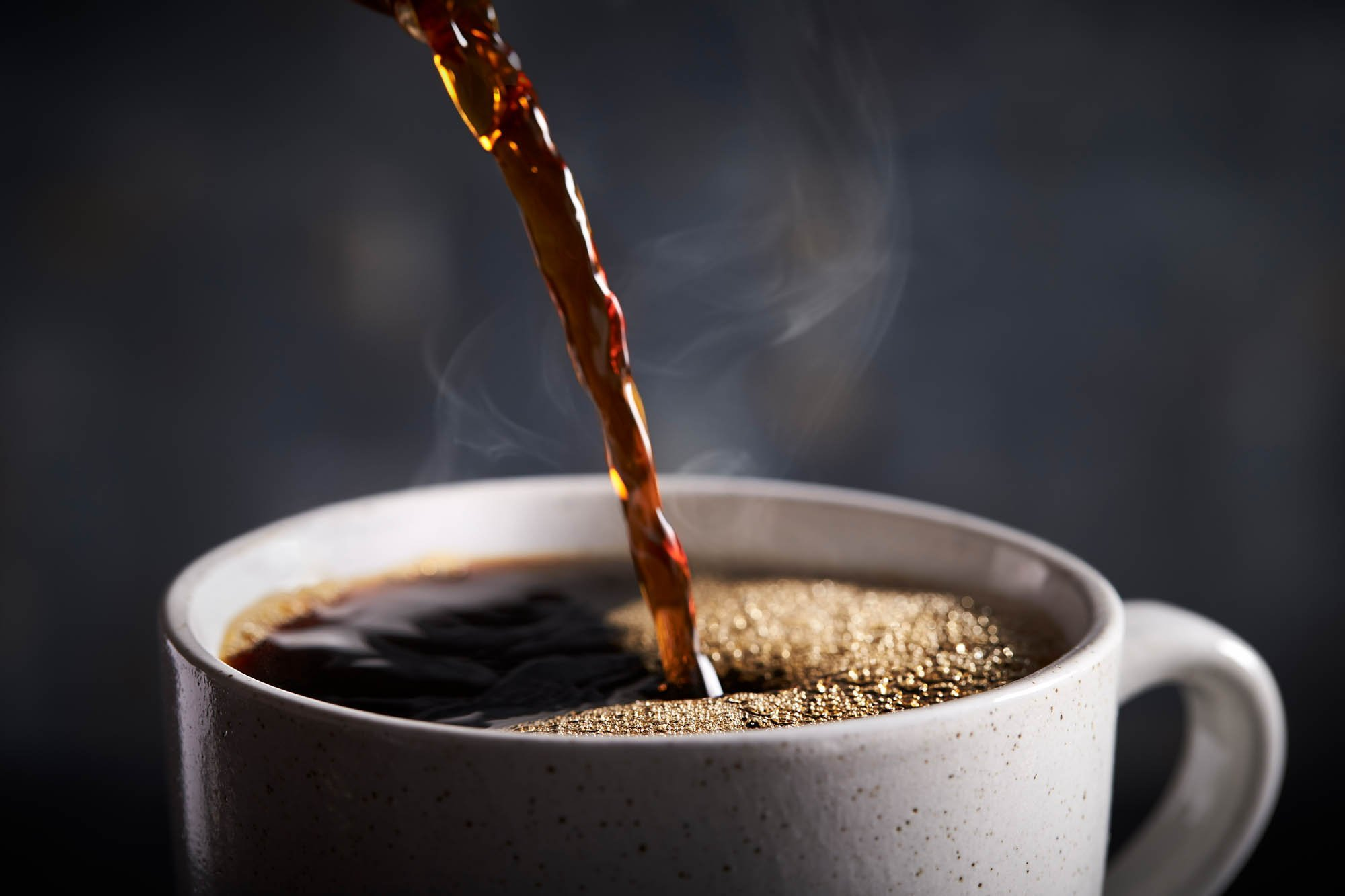 Coffee cup fast motion photography pouring