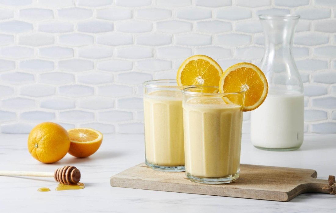 Two orange honey cream shakes