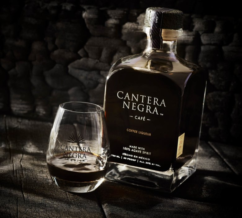 A dark and charred background with a coffee liqueur