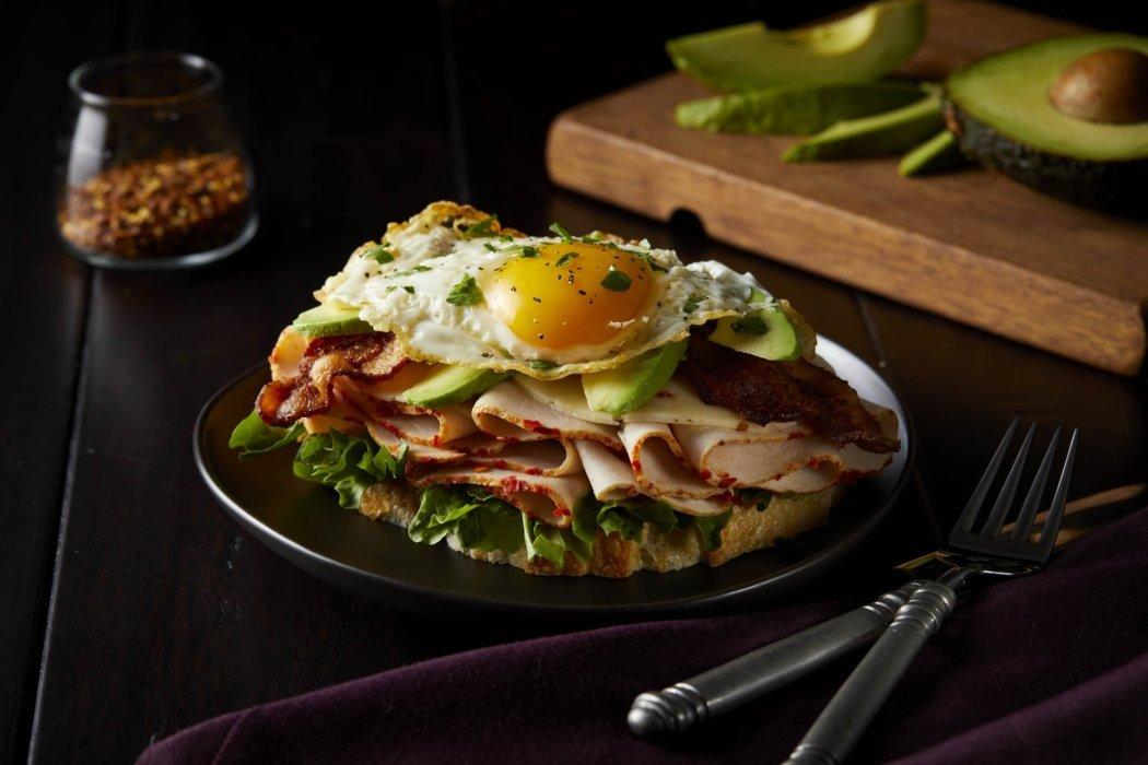 A delicous and rich open face turkey bacon avocado with egg