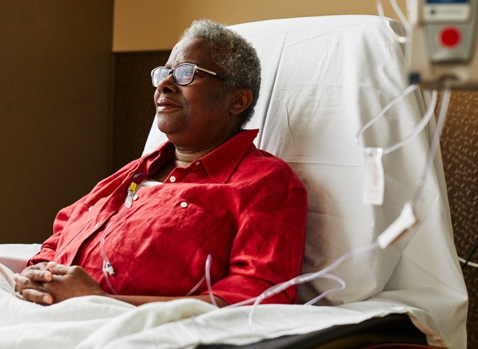 woman with glasses sitting getting medical treatment in healthcare