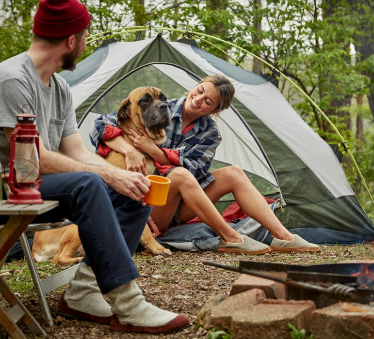 A woman, a man, a dog, in Tent - lifestyle photograph wearing Acorn Shoes