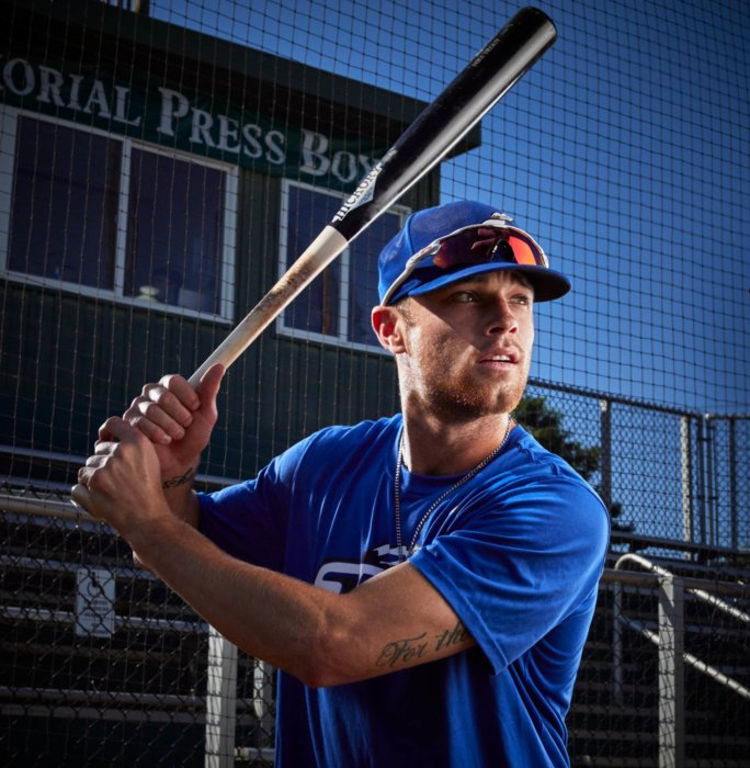 Portrait of a young base ball player holding a bat