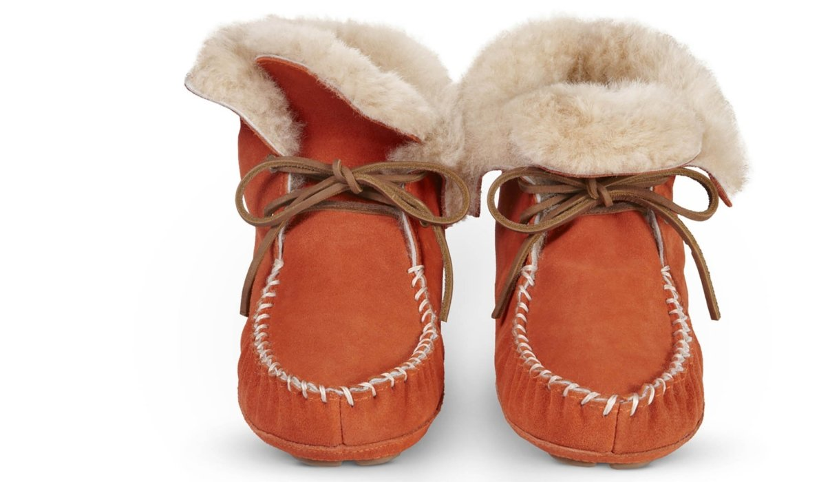 fluzzy light brown fur with brown moccasins white stitches in the front shoes product