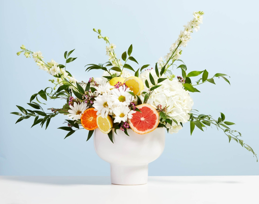 Beatuiful flower vase with orange and flowers