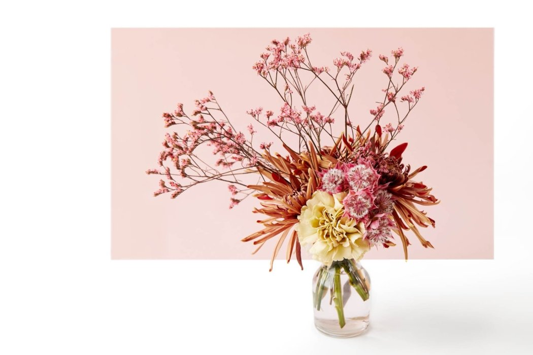 A beautiful flower arrangement of a vase on pick