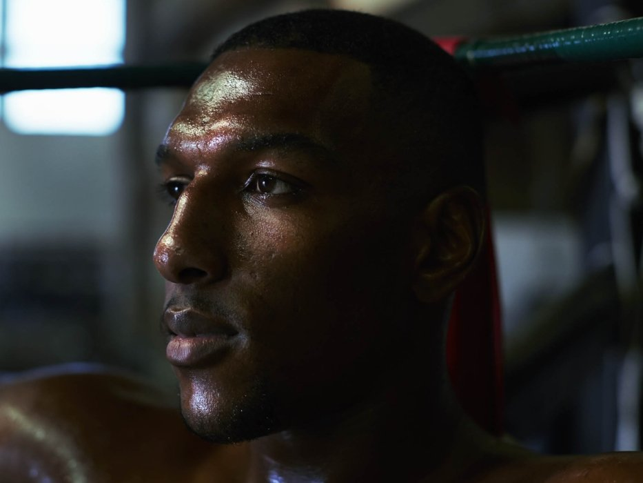 A portrait of a sweating boxer after a training session