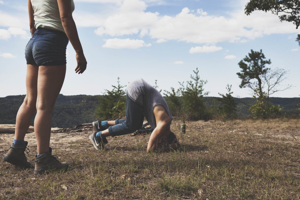 Two campers/hikers doing somersaults