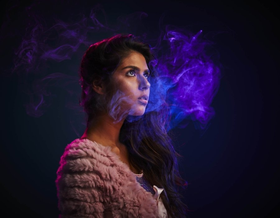 Smoke swirling around a woman wearing urban style clothes