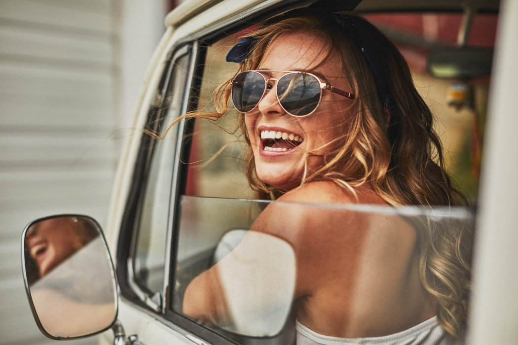 Girl with sunglasses in vintage van - lifestyle photography