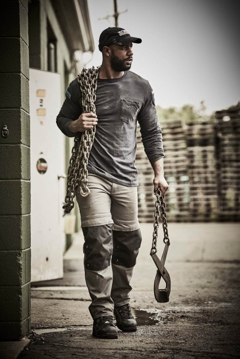 A man carrying a chain with work apparel - - work photography