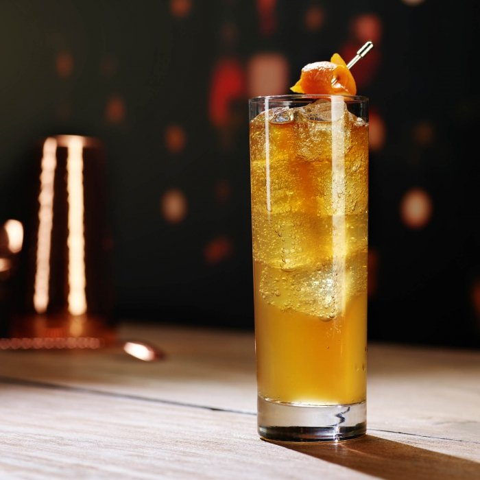 An orange with orange peel whiskey cocktail - Drink photography