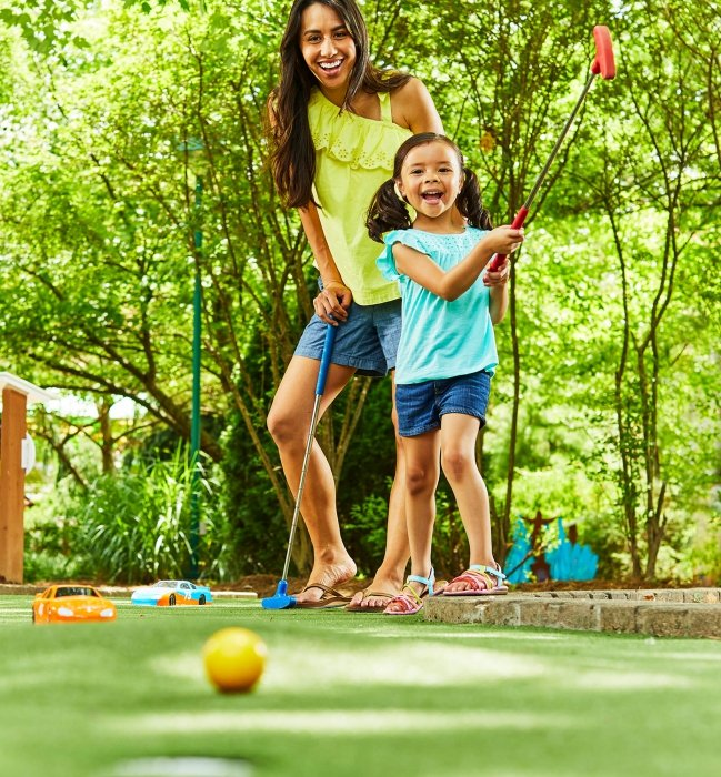 A young mom and daughter playing put put - lifestyle photography