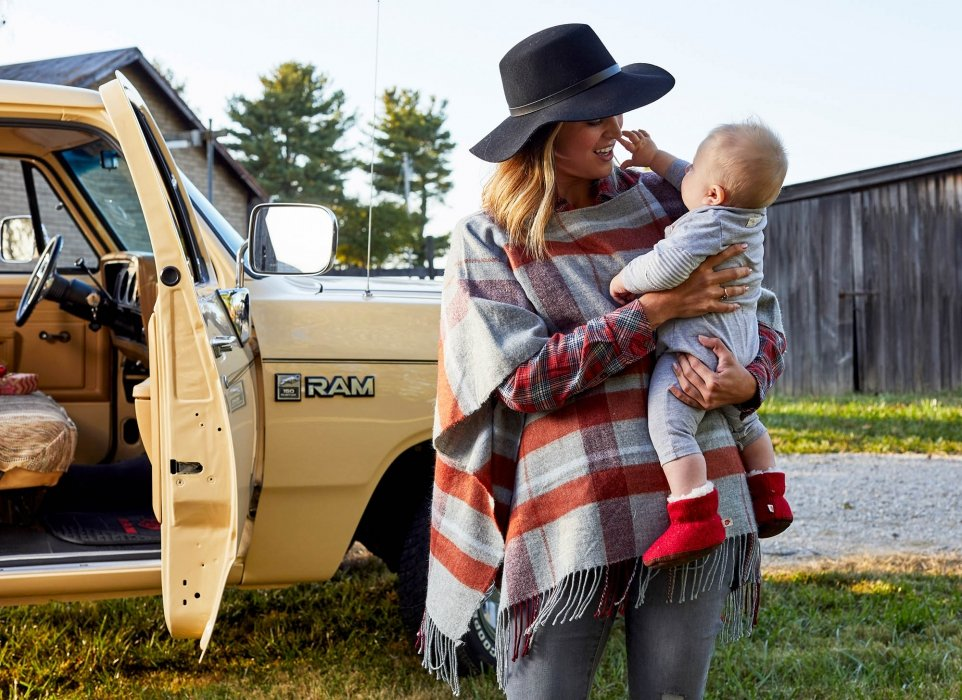A young mom holding her child - lifestyle photography