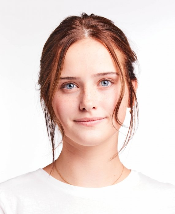 Portrait of a young woman on white - portrait photography