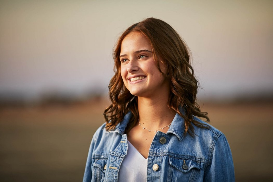 Portrait of a young woman in a field - portrait photography