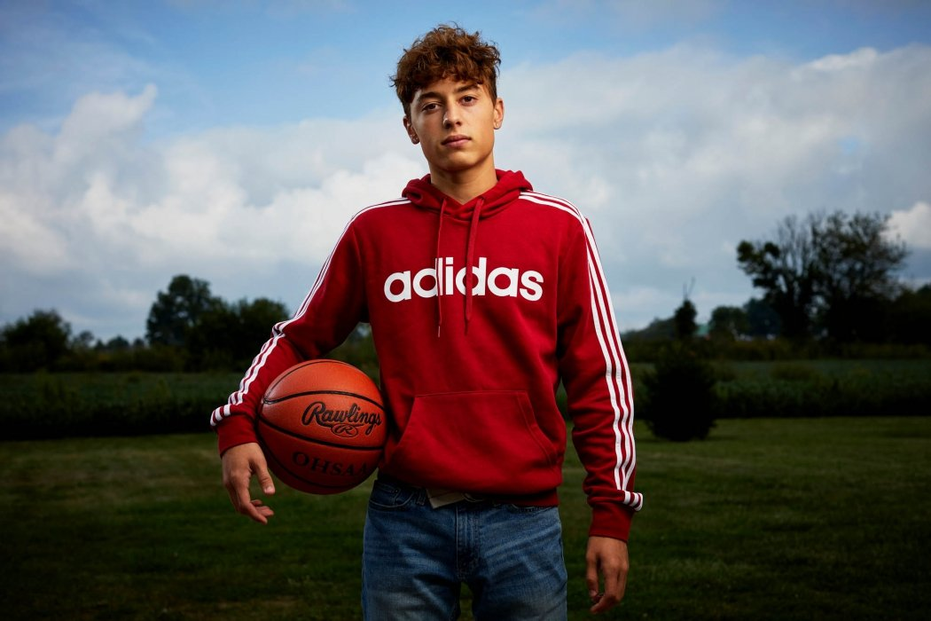 Portrait of a young man with a basketball