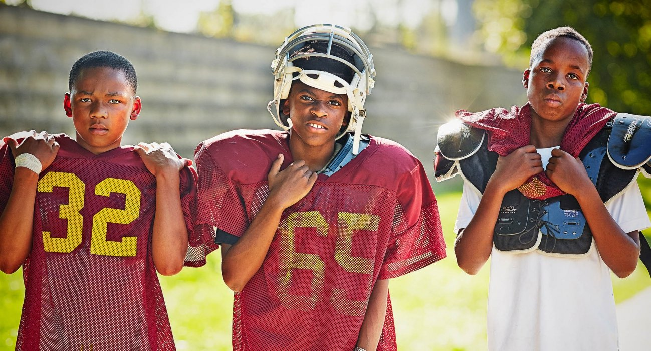 Portrait of Three young boy football players - sport photography