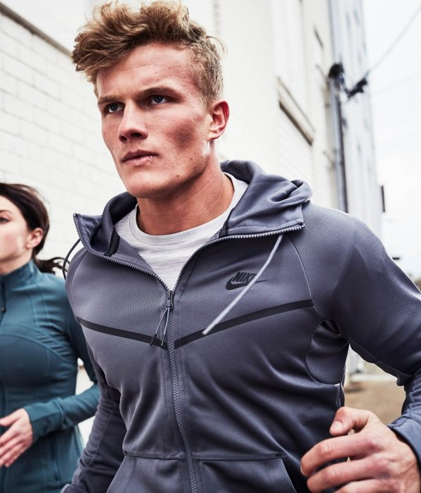A young man and woman running with athletic apparel - sport photography