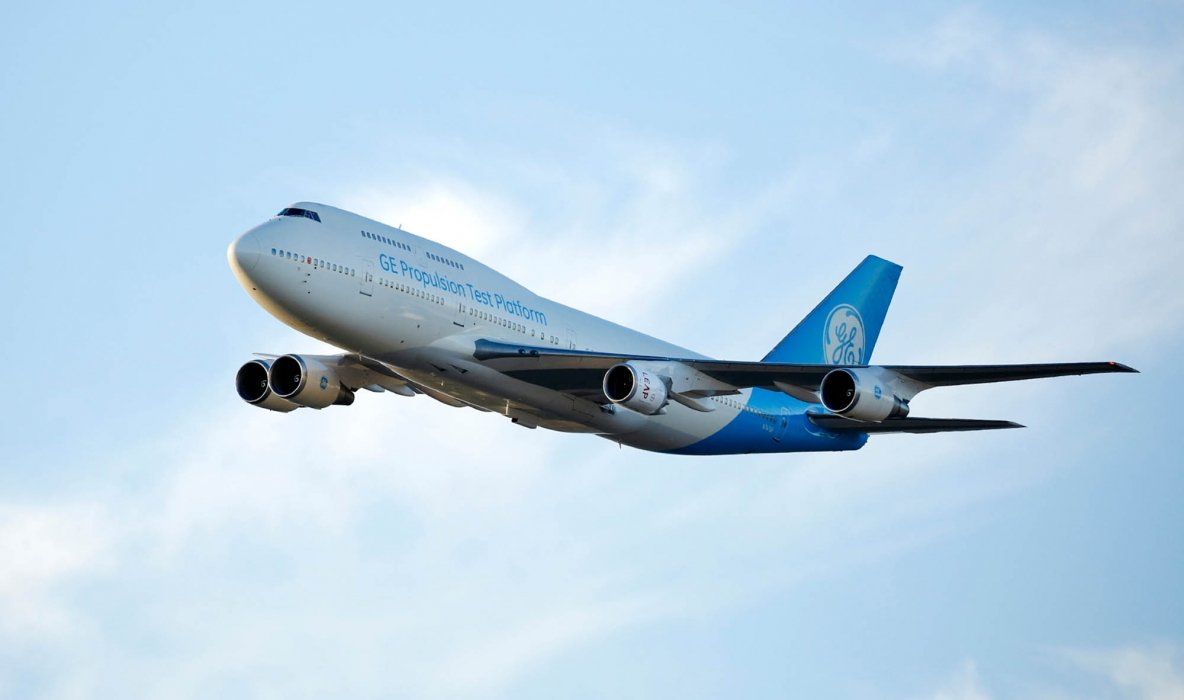 A GE aircraft engines plane flying - travel photography