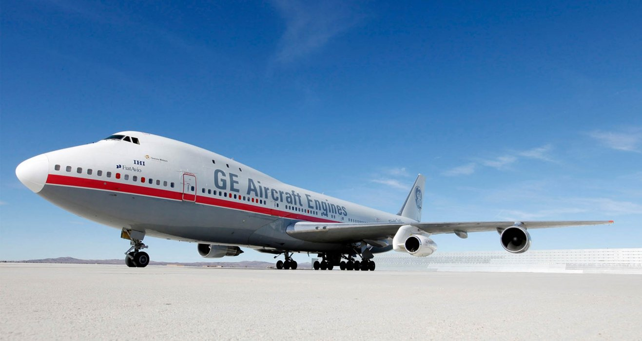 A GE aircraft engines plane on runway - travel photography