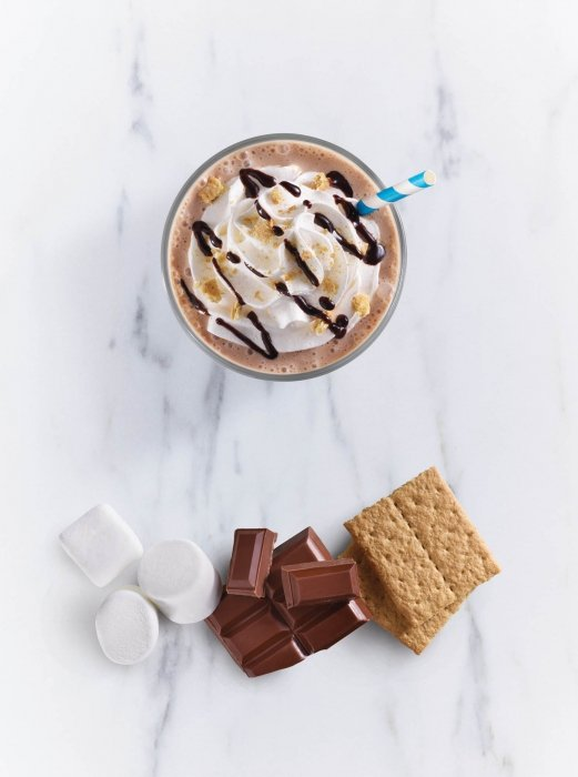 A smores milkshake with ingredients - drink photography