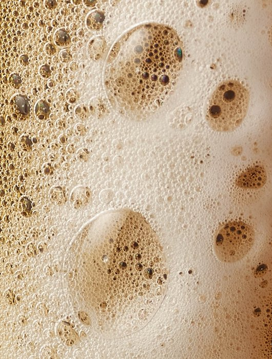 Foaming beer bubbles close up - drink photography