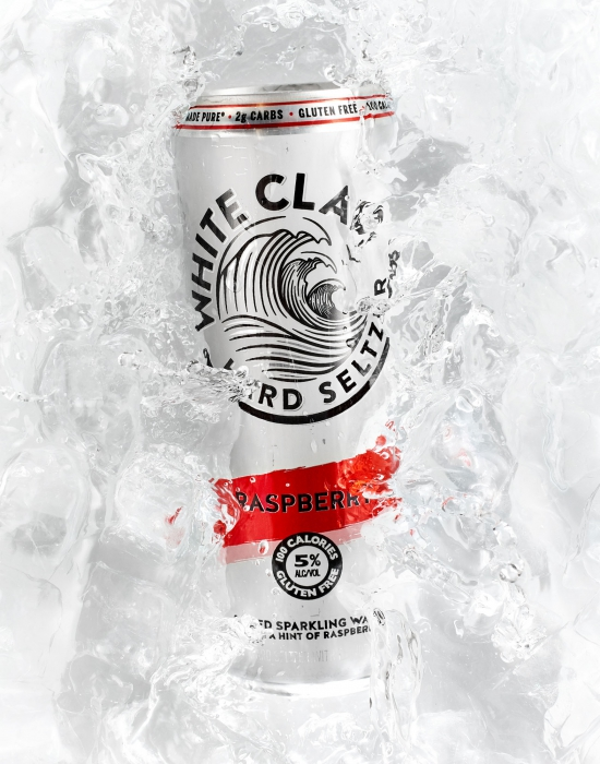 Raspberry white claw in ice bath - alcoholic drink photography