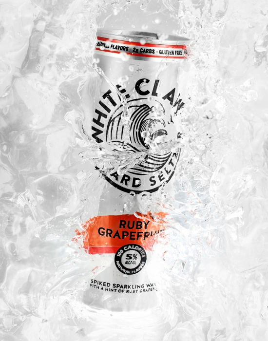 Ruby grapefruit white claw in ice bath - alcoholic drink photography