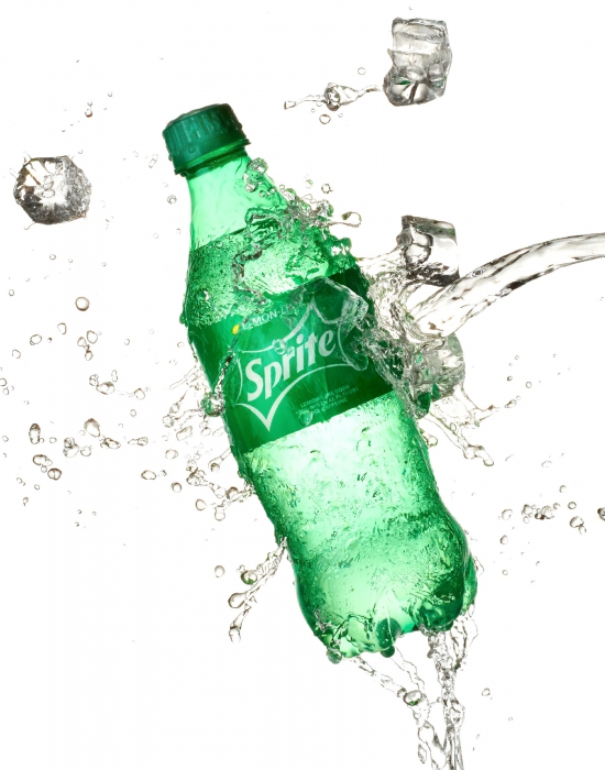 Sprite bottle with splashing ice and water - drink photography