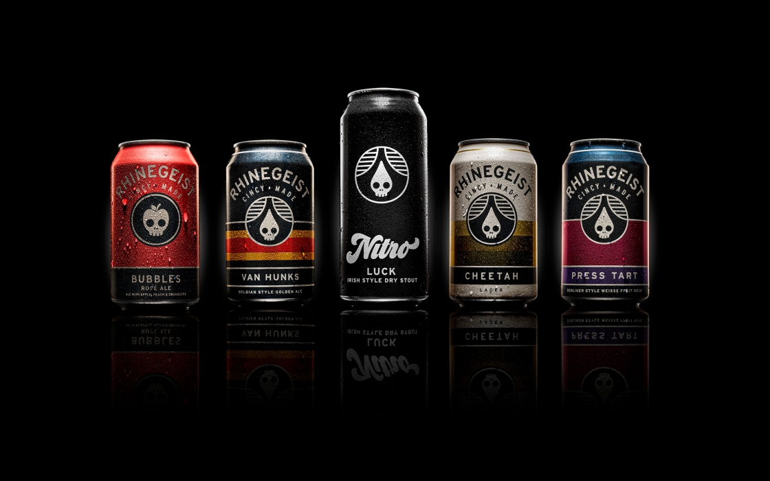 Line up of rhinegeist beer cans - drink photography