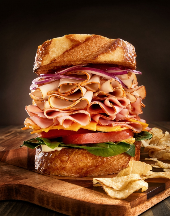A large delicious stack of sandwich with turkey ham and more - food photography