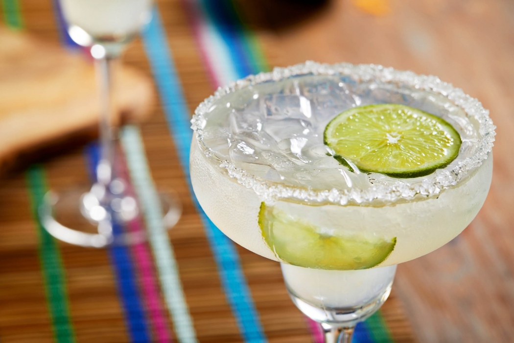 A salted rimmed fresh margarita - drink photography