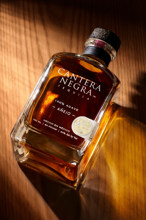 Cantera negra tequila on a wood surface - Anejo - Drink photography