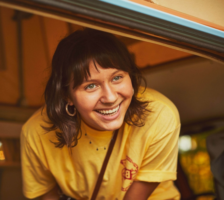 A young woman hipster in a vintage van with a nice smile - lifestyle photography