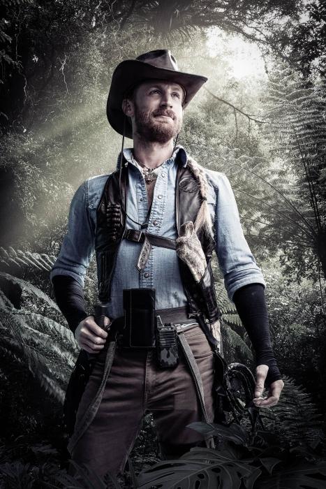 A young man with a adventure gear dino portrait of Jurassic quest cast - portrait photography - photo composite