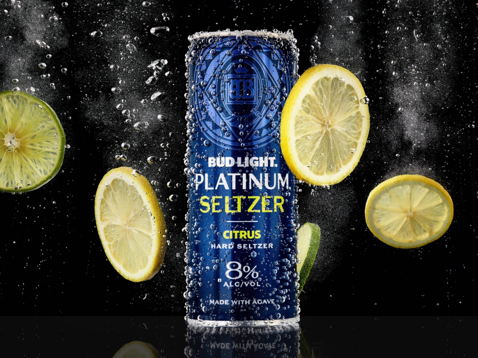 Bud light platinum seltzer citrus in carbonated water with floating limes and lemons - drink photography