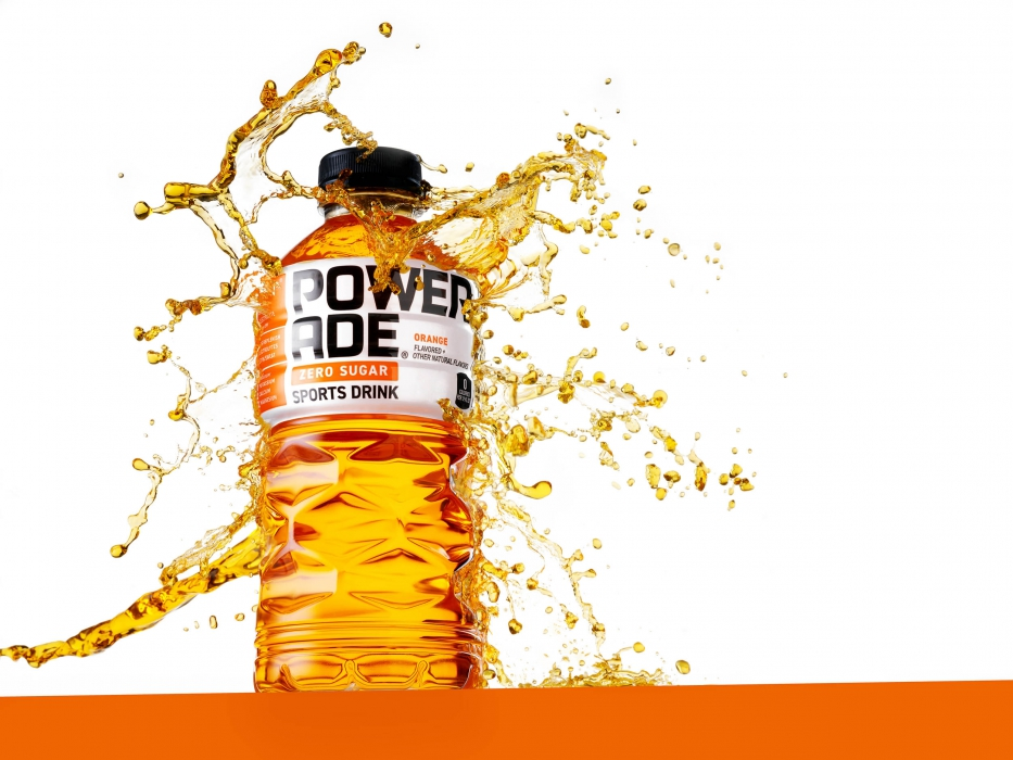 Splashing orange powerade on an orange line - drink photography