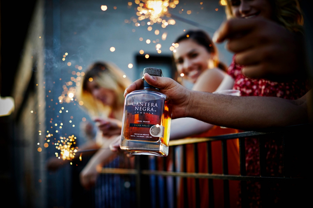 Cantera negra tequila at 4th of July party - lifestyle drink photography