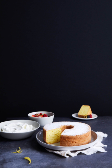 A beautiful lemon bundt cake with berries and whip cream - food photography