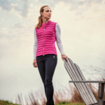 A woman wearing KJUS golf apparel with a dramatic look - lifestyle photography
