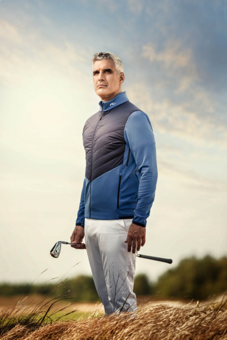 A man wearing KJUS golf apparel assessing in a dramatic portrait - lifestyle photography