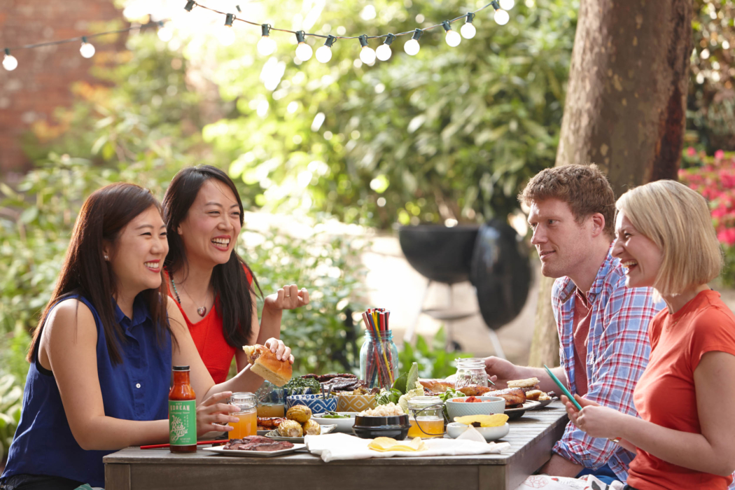 A group of friends enjoying a Korean BBQ cookout - food lifestyle photography