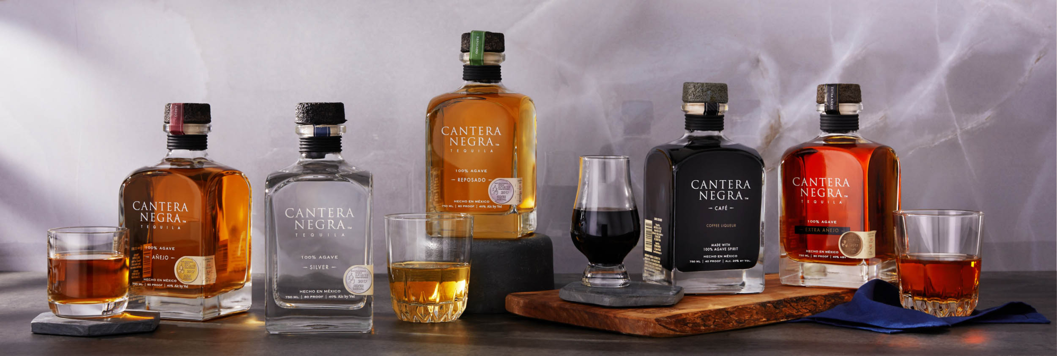 A line up of all cantera negra tequila products - drink photography