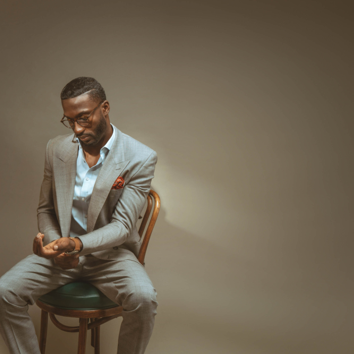 Portrait of a man wearing fashion suit looking adjusting watch - - modern photography - portrait photographer